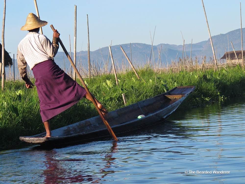 A fisherman uses his leg to help row on Inle Lake. (Will Jackson)