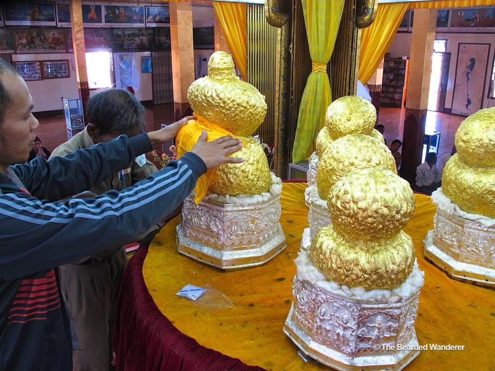 The five Buddha statues at Phaung Daw Oo Pagoda have been plastered with so much gold leaf they are unrecognisable. (Will Jackson)