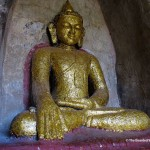 A Buddha statue covered in gold leaf applied by devotees seeking merit. (Will Jackson)
