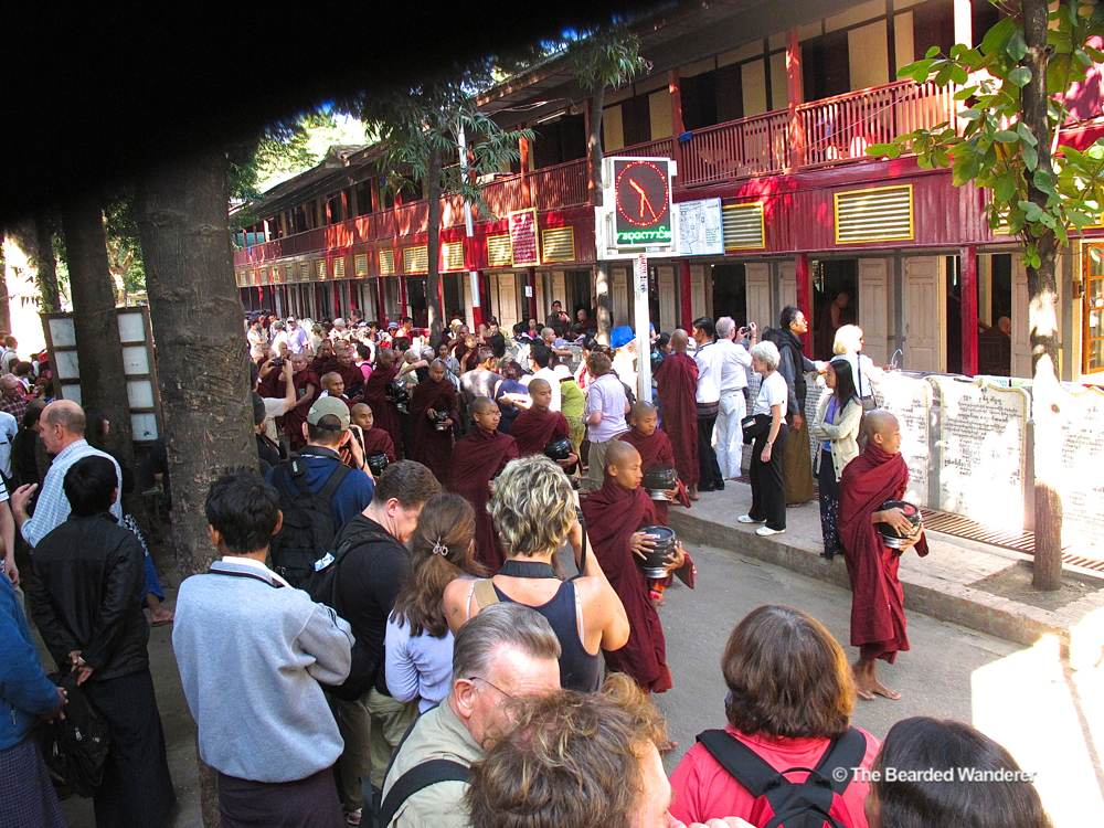 Tourists gather to watch monks at Mahagandayone Monastery. (Will Jackson)