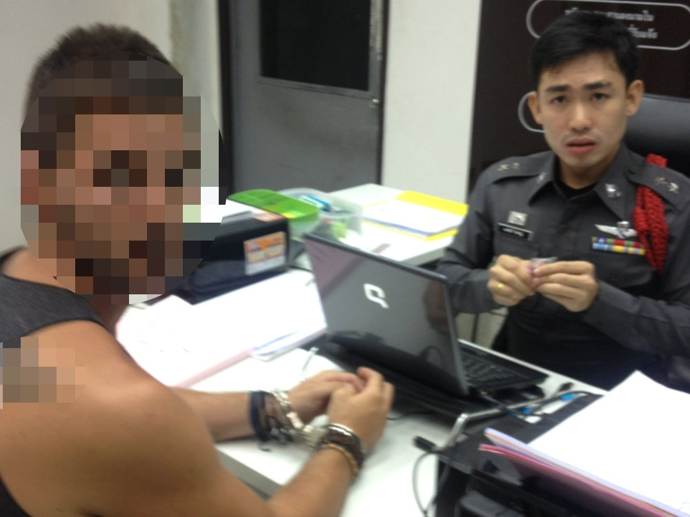 John getting processed at the Khao San Road police station.