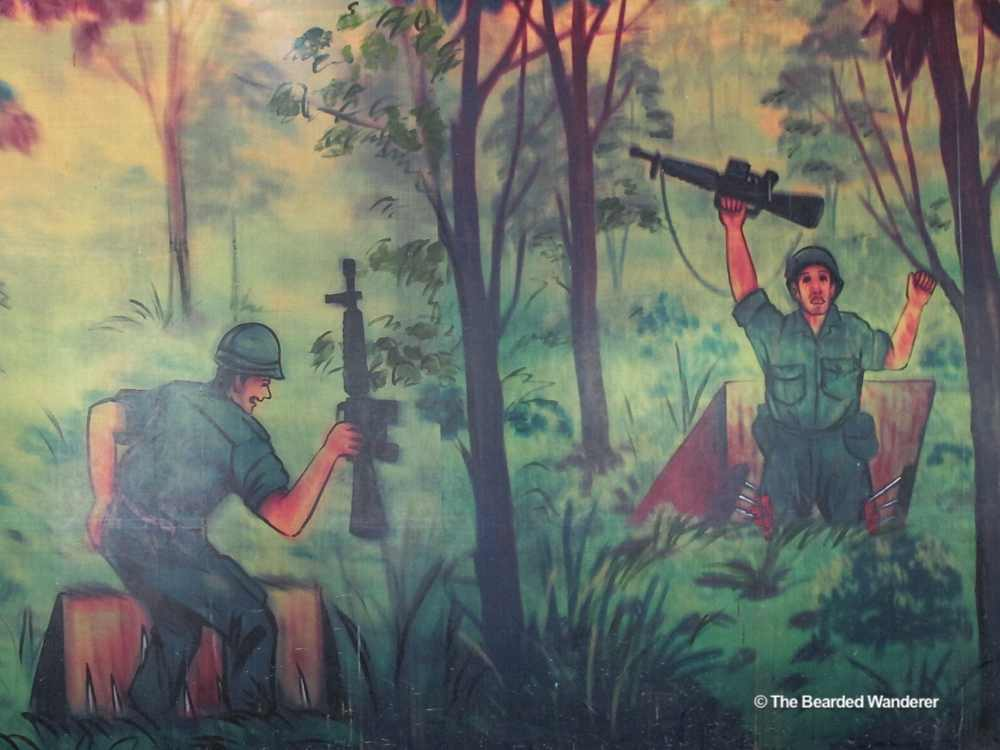 A mural at the Cu Chi tunnels memorial showing some of the Viet Cong's pit traps in action. (Will Jackson)