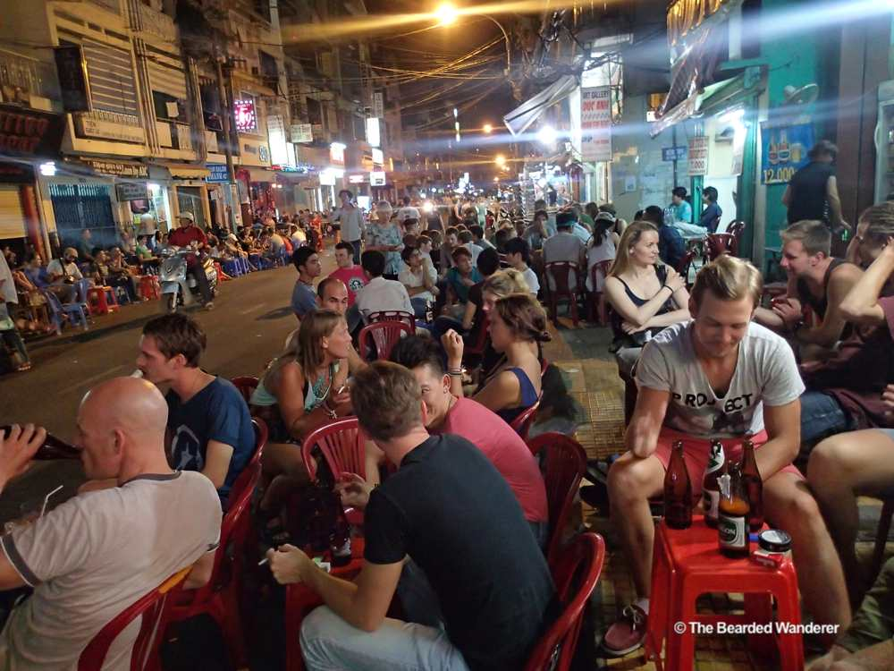 Backpackers drink cheap beer in Saigon's Bui Ven Street. (Will Jackson)