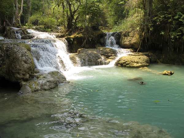 The pale jade pools at the Kuang Si Waterfalls. (Will Jackson)
