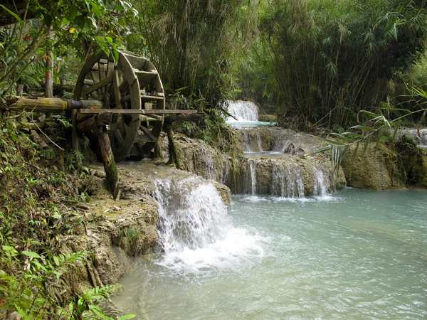 A non-functioning waterwheel at the Kuang Si Waterfalls. (Will Jackson)